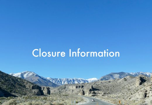 Closure information white words over a blue sky with Charleston peak in the background