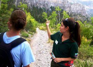 Trail Host gives directions to a hiker