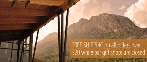Free shipping on all orders over $20 in front of jagged mountain surrounded by clouds at sunset