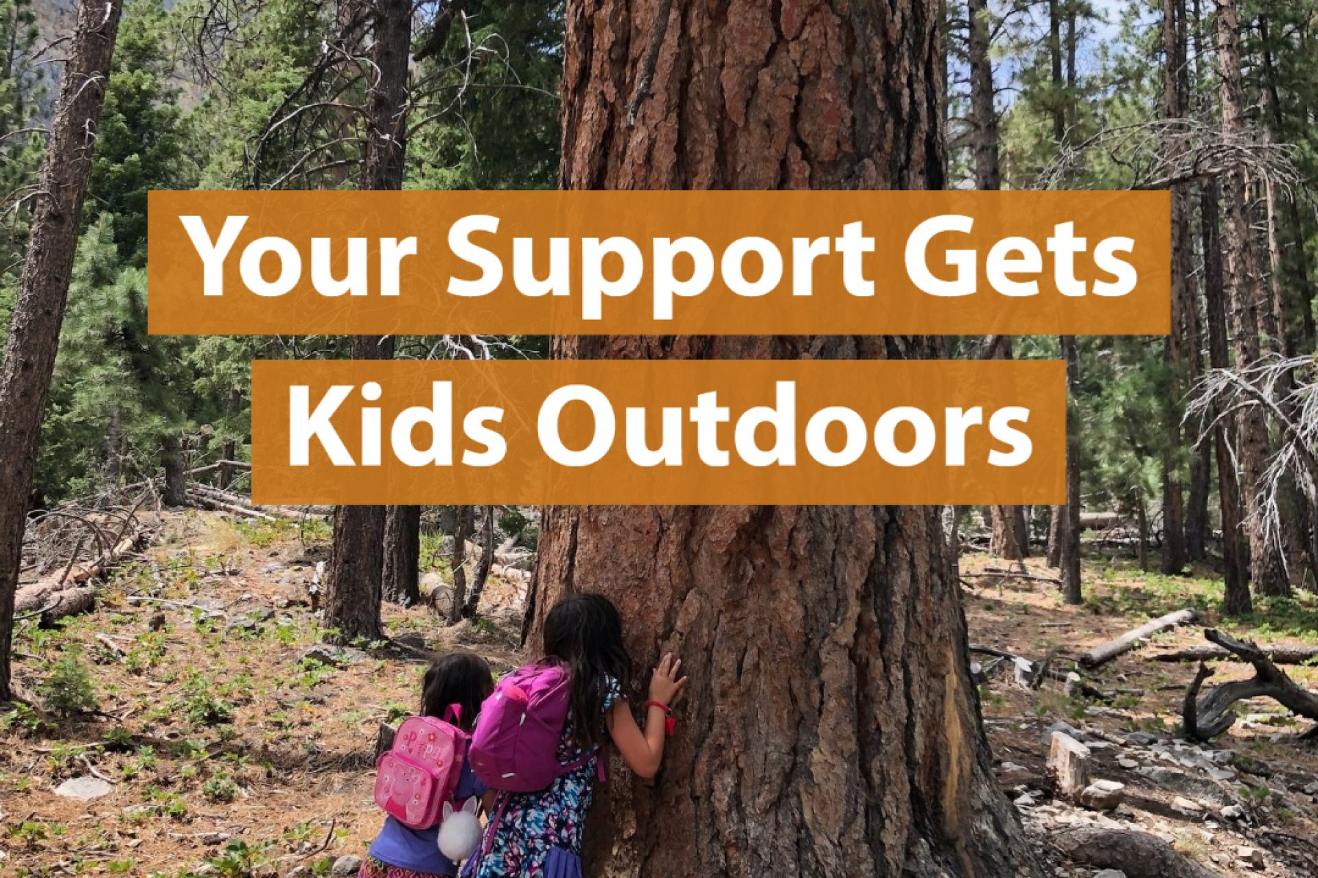 Kids smelling sweet scent of a large ponderosa pine tree in forest under title your support gets kids outdoors