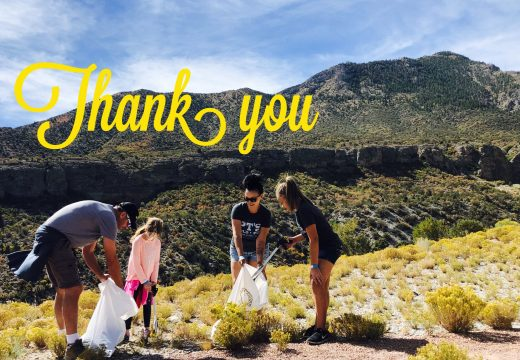 Thank you with family collecting litter
